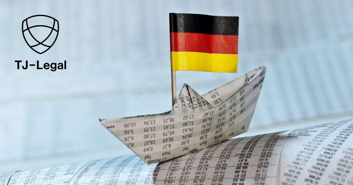 papierová loďka s nemeckou vlajkou
